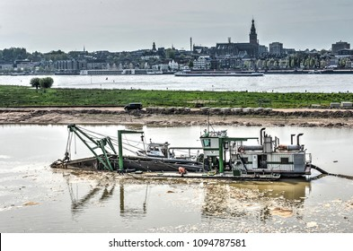Nijmegen, the Netherlands, May 8, 2015: work in progress on the new channel of the river Waal, with the city of Nijmegen in the background