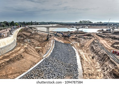 Nijmegen, the Netherlands, May 8, 2015: Work in progress on the bank of the new channel of the river Waal