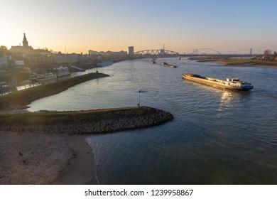 Nijmegen, the Netherlands - November 16 2018: cargo river barges passing near Nijmegen during time of low river levels