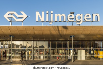 Nijmegen, Netherlands - November 7, 2017: Front of railway central station Nijmegen with travelers and shops.