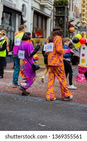 Nijmegen/The Netherlands - February 11 2018: Carnaval in Nijmegen to celebrate the beginning of Lent, Parade float with 70's inspired outfits