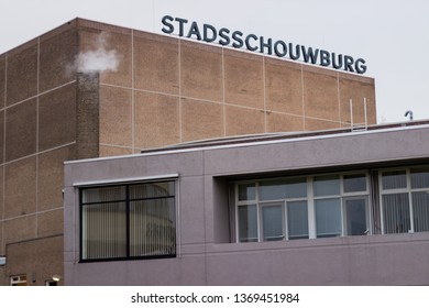 Nijmegen/The Netherlands - January 27 2018: The Stadsschouwburg Building in Nijmegen Central with smoke coming out of its chimney on a cold winter morning