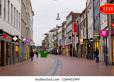 Nijmegen/The Netherlands - January 27 2018: The main street in Nijmegen's shopping precinct while shop owners prepare for opening on a cold winter morning.