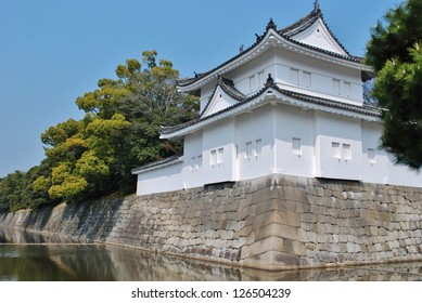 Nijo Castle in Kyoto, Japan is surrounded by rock walls and a deep moat.