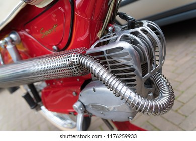 NIJVERDAL, NETHERLANDS - MAY 7, 2017: Shiny chrome engine of a classical red moped