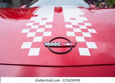 NIJVERDAL, NETHERLANDS - MAY 7, 2017: Chevrolet Corvette logo on a red vintage oldtimer car