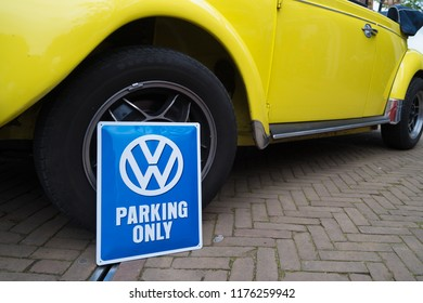 NIJVERDAL, NETHERLANDS - MAY 7, 2017: Shield with VW parking only on it  in front of a vintage yellow beetle
