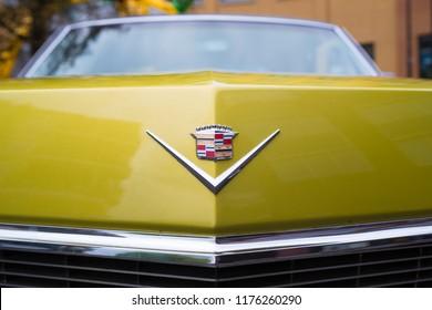 NIJVERDAL, NETHERLANDS - MAY 7, 2017: Cadillac emblem on a yellow oldtimer car