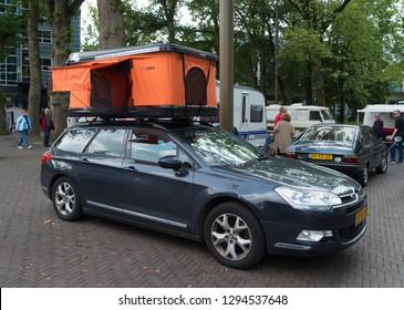 NIJVERDAL, NETHERLANDS - SEPTEMBER 17, 2017: Car with rooftop tent at a camping exhibition