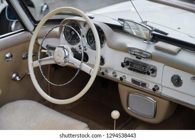 NIJVERDAL, NETHERLANDS - SEPTEMBER 17, 2017: Steering wheel and interior of a vintage Mercedes Benz 190 SL