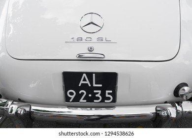 NIJVERDAL, NETHERLANDS - SEPTEMBER 17, 2017: Closeup of the back of a vintage whtie Mercedes Benz 190 SL at an exhibition