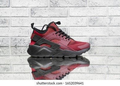 Nike Air Huarache burgundy woman's vintage sport shoes, trainers detailed close up shot on. Most popular model of sneakers. Street fashion. LOS ANGELES, CALIFORNIA, 02/02/2020
