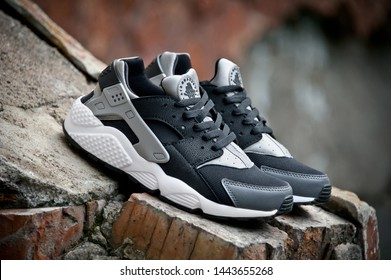 Nike Air Huarache sport shoes shot outdoors on colorful background. Nike sneakers, trainers close up view. Sport and casual footwear concept. Krasnoyarsk, Russia - August 11, 2015