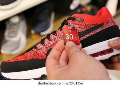 Nike Air Max shoes in hand, sale - 30%. Ukraine, Kiev - June 20, 2017