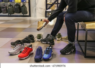 Nike store. Man buys sneakers Nike Air Max - Ukraine, Kiev - June 20, 2017