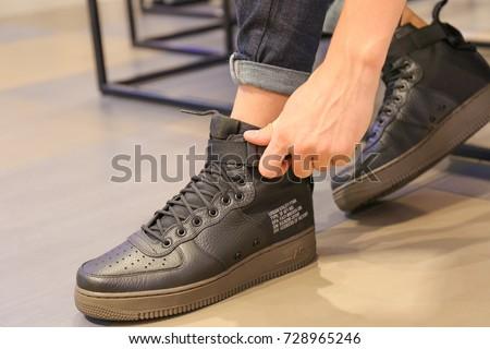free shipping eb92d c0fd8 Nike store. Man buys sneakers Nike Air Force 1 - Ukraine, Kiev - august