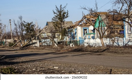 NIKISINO, UKRAINE - Feb 27, 2015: Ruined house. Village Nikishino located 20 km from Debaltseve, Ukrainian military was abandoned three days ago. Separatist forces attacked it for several days.