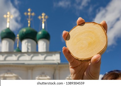 Nikitsky monastery with bokeh and blur effect in Pereslavl Zalessky and cut down a tree in his hand for the copy space