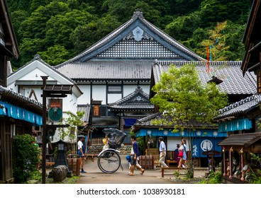 Nikko, Japan - June 29, 2014: busy city street of medieval  Edo with pedestrian and rickshaw in Edo wonderland theme park