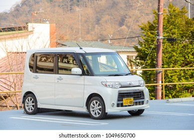 "Nikko, Japan - March 31, 2015 : The mini van car brand ""Daihatsu"" parking in Nikko parking area in the morning"
