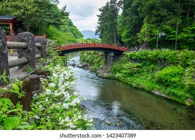 NIKKO / JAPAN - May 19 2019: Shinkyo Bridge during Spring Season with green trees