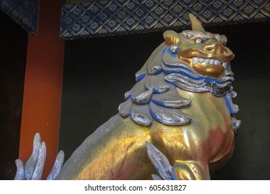 NIKKO, JAPAN - November 16, 2016: Guardian lion at Tosho-gu, a Shinto shrine dedicated to Tokugawa Ieyasu, located in Nikko, Japan. A World Heritage Site since 1999.
