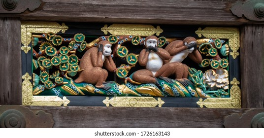 Nikko, Japan; October 2019: Three wise monkeys carved on wood who see no evil, hear no evil, speak no evil. Traditional symbol in Japanese and Chinese cultures. Shinto sanctuary Thosho-gu. Close up