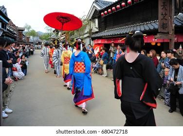 NIKKO, JAPAN - OCTOBER 6, 2015: Geisha parade at Edo Wonderland in Nikko Edomura Edo Wonderland is a history theme park recreating Japanese town life during the Edo Period 1603-1868.