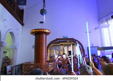 NIKOLA TESLA MUSEUM, BELGRADE, SERBIA - 19 September 2015. Visitors are making an experiment with the huge Tesla Coil in the museum.