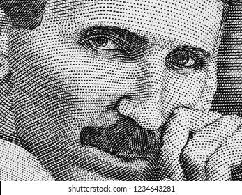 Nikola Tesla portrait on Serbia 100 dinars extreme macro, genius physicist. Black and white