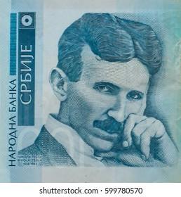Nikola Tesla portrait on Serbia 100 dinars banknote close-up.
