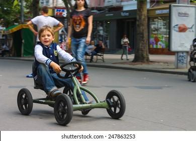 NIKOLAEV, UKRAINE - June 21, 2014: Kid in the play area riding a toy car