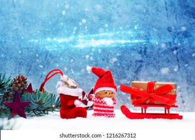 Nikolaus with sleigh, Christmas decorations in the snow