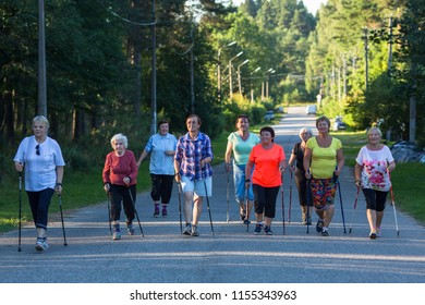 """NIKOLSKY /LENINGRAD.REG, RUSSIA - YUL 29, 2018: Participants of action of """"Second Breath"""" sports club for pensioners, supported by the Russian Railways charity Fund """"Honor"""""""