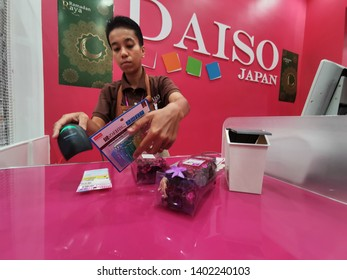 Nilai, Malaysia - 19/5/2019 : Daiso Japan staff at the cashier's counter in AEON Nilai. Daiso is a large franchise of 100-yen shops founded in Japan with its headquarters are in Higashihiroshima
