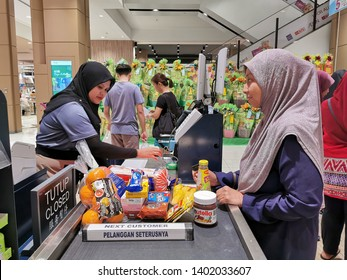 Nilai, Malaysia - 19/5/2019 : People queueing to pay at the cashier counter in AEON shopping complex in Nilai, Negeri Sembilan