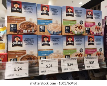 Nilai, Malaysia - 26 January 2019 : Assorted a box of QUAKER Instant Oatmeal flavour display for sell in the supermarket shelf.
