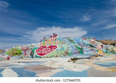 NILAND, CALIFORNIA - AUGUST 21 2018: Leonard Knights painted Salvation Mountain on Beal Road  outside of Niland, California