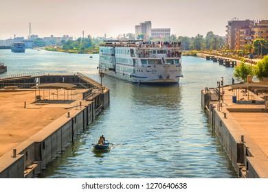 Nile river, Egypt - Nov 7th 2018 - A big touristic cruiser heading to a lock in the Nile River in Egypt