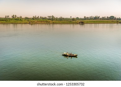 Nile river, Egypt - Nov 8th 2018 - Two local trader in a small boat in the middle of the Nile River in Egypt