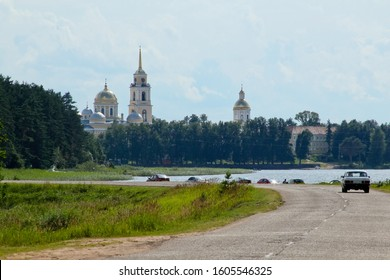 Nilov Monastery on Stolobny Island in Lake Seliger. Cars on the road. Russia