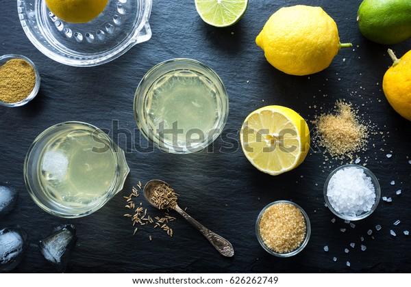 Nimbu Pani Indian lemonade, refreshing drink for hot days. Home made natural isotonic made with water, lemon juice, sugar, salt and cumin. Top view.