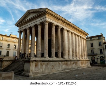 Nimes, France - Circa October 2019: View of Maison Carrée in the old town of Nimes, France