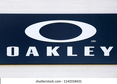 Nimes, France - July 1, 2018: Oakley logo on a wall. Oakley is a glasses brand created by Jim Jannard in 1975 and a subsidiary of the Italian company Luxottica