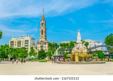 NIMES, FRANCE, JUNE 20, 2017: Church of Sainte Perpetue and fountain Pradier in Nimes, France