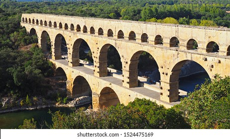 Nimes / France - September 29, 2019: The Pont du Gard, the surviving section of the Roman aqueduct built in the 1st Century A.D.  that still spans the Gard River in Nimes, France.