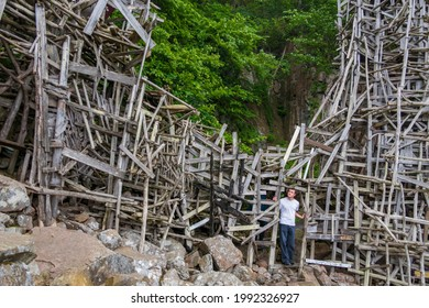 Nimis, Sweden June 12, 2021 Tourists visit the Nimis art installation by artist Lars Wiks made of driftwood on the southwest rocky shores of Sweden.