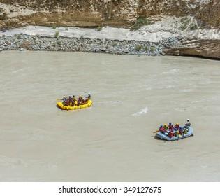NIMU, INDIA - JULY 30, 2015: Rafting on the Zanskar river - The confluence of the Indus and Zanskar river - Tibet, Leh district, Western Ladakh, Himalayas, Jammu and Kashmir, Northern India