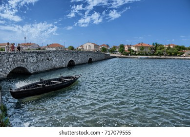 Nin ,Croatia - August 11, 2017: An example of an ancient Croatian ship called Condura Croatica dating back to XI century berthed in the Nin lagoon in front of the Lower Bridge, city of Nin, Croatia
