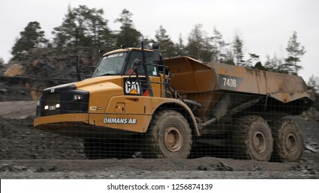 Ninashamn, Sweden - Nov 21, 2018: articulated dump truck Caterpillar 740B at the work site